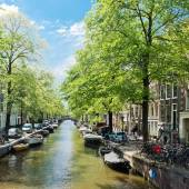 Amsterdam with green canal