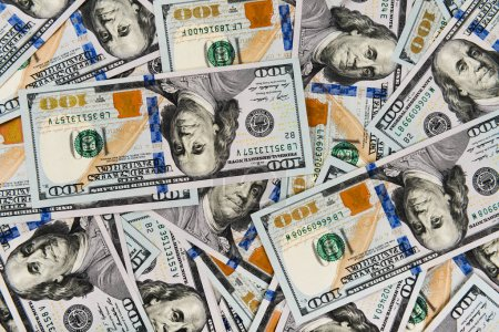 Photo for Closeup of pile of one hundred dollar bills, colorful money background - Royalty Free Image