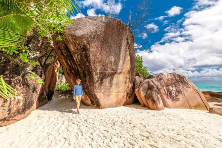 Photo for Woman walking at beautiful Seychelles beach, Praslin, Anse Lazio - Royalty Free Image