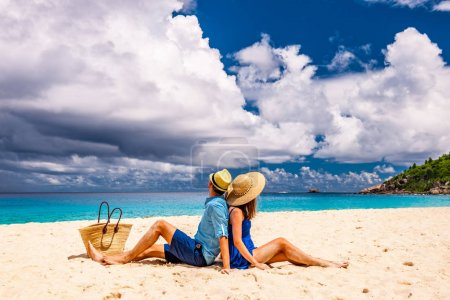 Photo for Couple relaxing on a tropical beach Anse Intendance at Seychelles, Mahe. - Royalty Free Image