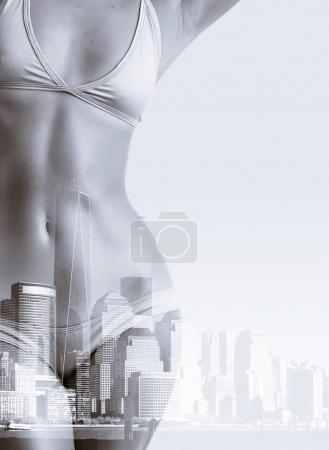 Double exposure portrait of woman in bikini and New York City skyline