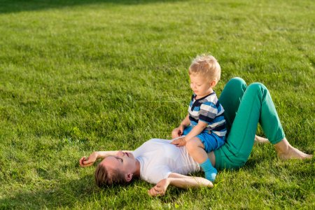 Woman and child having fun outdoor