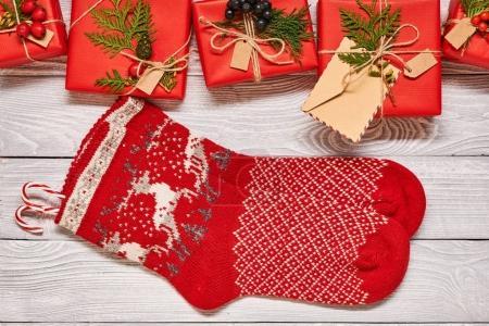 Christmas presents and socks on wood