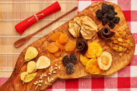 Dried fruits on red tablecloth