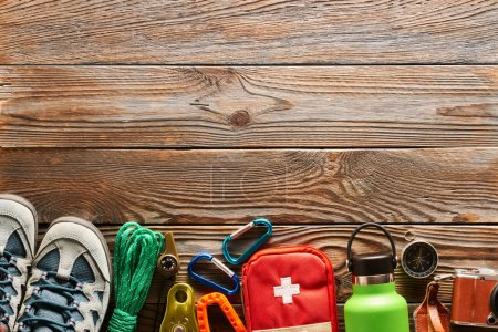 Photo for Travel items for hiking tourism still life over wooden background - Royalty Free Image