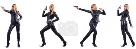 Woman in leather costume with gun isolated on whit...