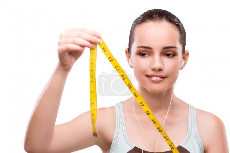 Young woman with centimeter in diet concept