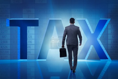 Businessman in high taxes concept