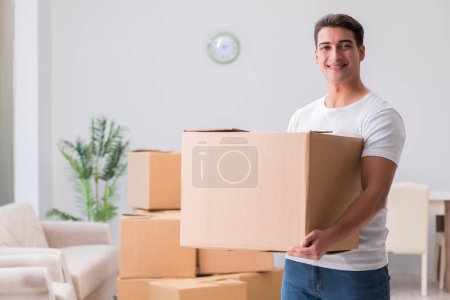 Photo for Man delivering heavy boxes at home - Royalty Free Image