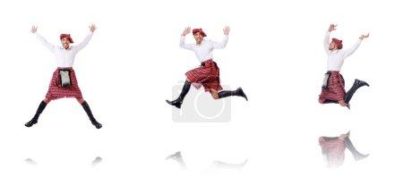Photo pour Écossais homme dansant sur blanc - image libre de droit