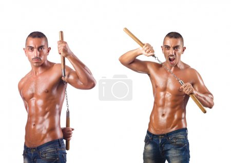 Martial arts warrior with nunchucks on white