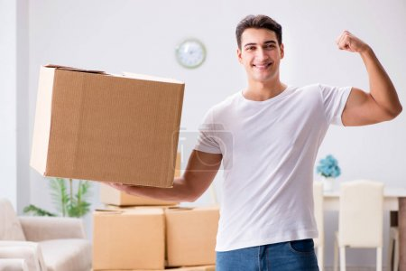 Photo for Young man moving boxes at home - Royalty Free Image