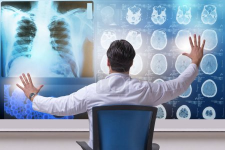 Male doctor looking at MRI scans