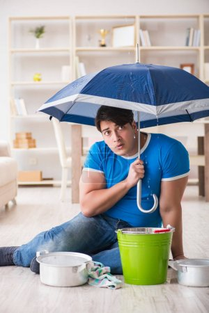 Photo for Man at home dealing with neighbor flood leak - Royalty Free Image