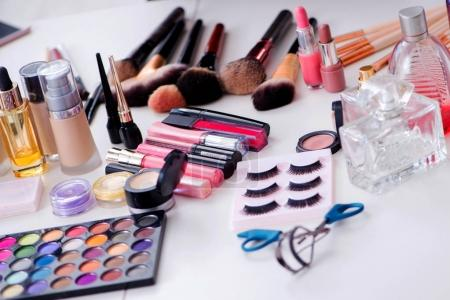 Collection of make up products displayed on the table