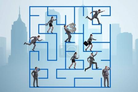Business people getting lost in maze uncertainty c...