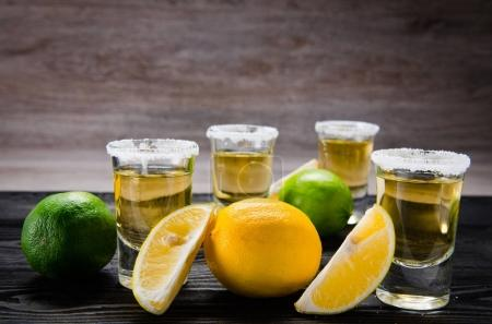Photo for Tequila drink served in glasses with lime and salt - Royalty Free Image