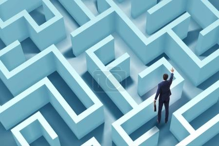 Photo for Businessman is trying to escape from maze labyrinth - Royalty Free Image