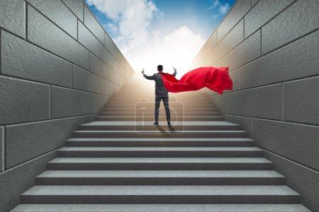Photo pour Un super-héros du monde des affaires réussit le concept de carrière - image libre de droit