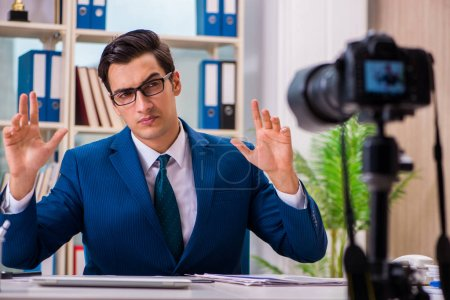 Photo for Businessman recording a video for vlog - Royalty Free Image