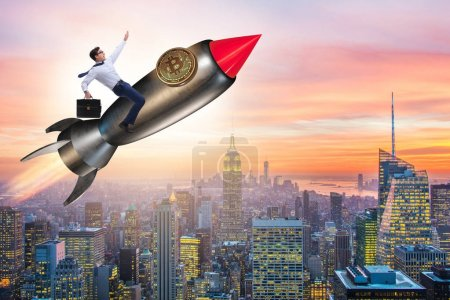 Photo for Businessman flying on rocket in bitcoin price rising concept - Royalty Free Image