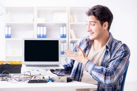 Photo for Professional repairman repairing computer in workshop - Royalty Free Image