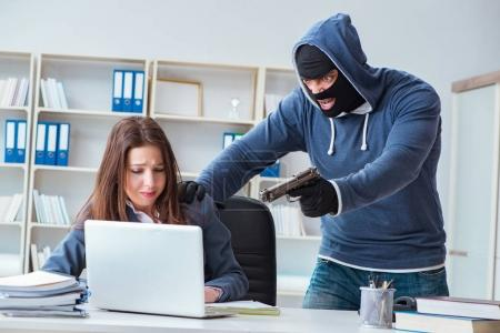 Photo for Criminal taking businesswoman as hostage in office - Royalty Free Image
