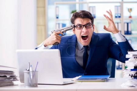 Photo for Stressed businessman thinking of suicide due to excessive workload - Royalty Free Image