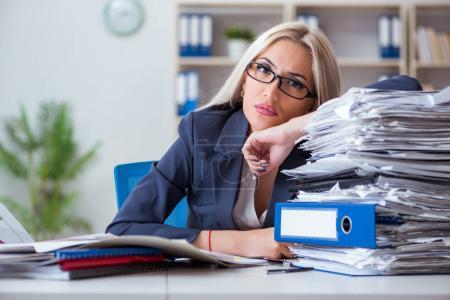 Photo for Busy businesswoman working in office at desk - Royalty Free Image