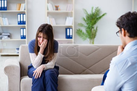 Photo for Psychologist counselling woman beaten by husband - Royalty Free Image