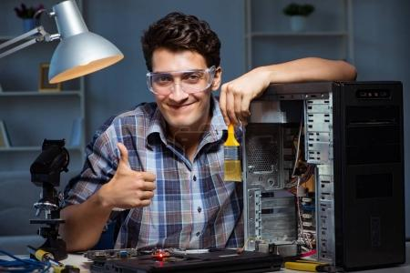 Photo for Computer repair man cleaning dust with brush - Royalty Free Image