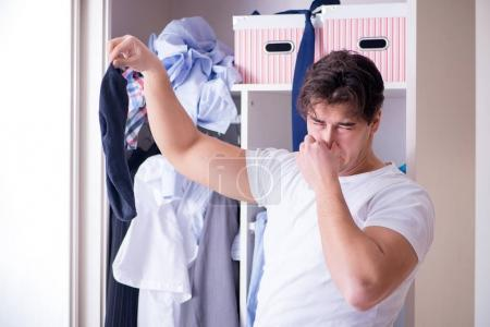 Photo for Man helpless with dirty clothing after separating from wife - Royalty Free Image