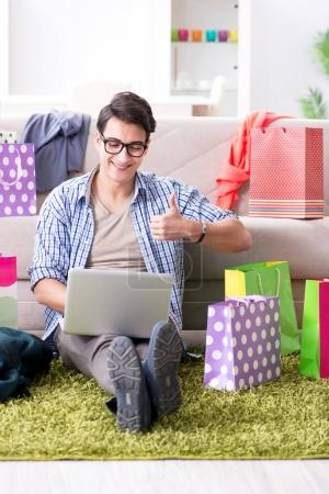 Photo for Young man buying clothing online and running blog - Royalty Free Image
