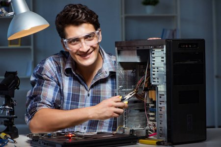 Photo for Man repairing computer desktop with pliers - Royalty Free Image