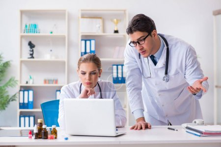 Photo for Male and female doctor having discussion in hospital - Royalty Free Image