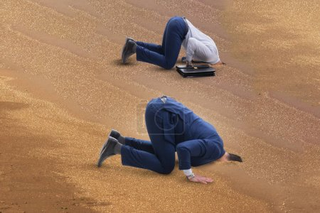 Photo for Businessman hiding his head in sand escaping from problems - Royalty Free Image