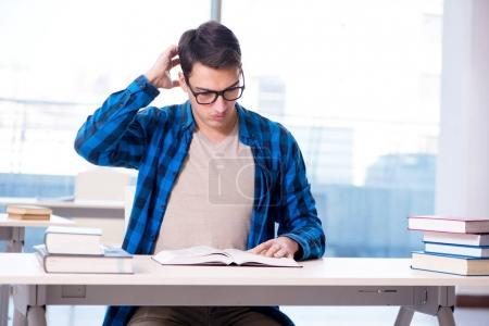 Photo for Student studying in the empty library with book preparing for exam - Royalty Free Image
