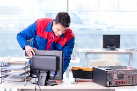 Photo for Computer repairman specialist repairing computer desktop - Royalty Free Image
