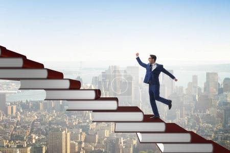 Photo for Businessman student climbing the ladder of education books - Royalty Free Image