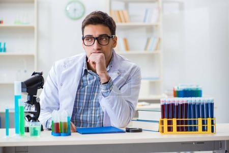 Photo for Young chemist student working in lab on chemicals - Royalty Free Image