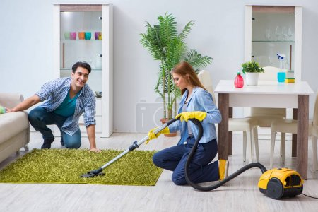 Photo for Young family cleaning the house - Royalty Free Image