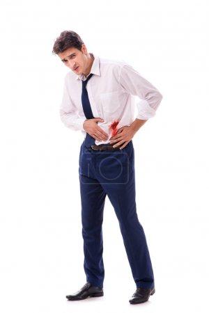 Photo pour Homme d'affaires blessé avec sang taches isolé sur fond blanc - image libre de droit