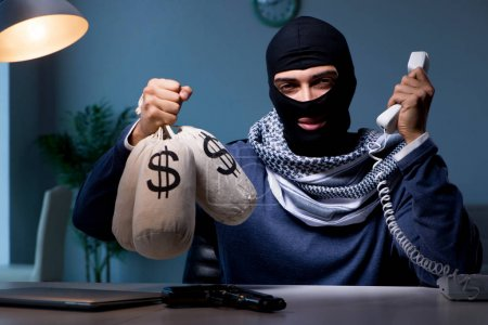 Photo for Terrorist asking for money ransom over the phone - Royalty Free Image