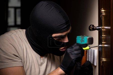 Photo for Burglar wearing balaclava mask at crime scene - Royalty Free Image