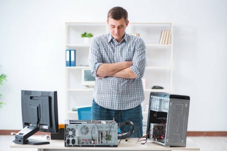 Photo for Young technician repairing computer in workshop - Royalty Free Image