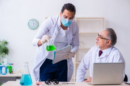 Photo for The two chemists working in the lab - Royalty Free Image