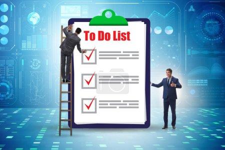 Photo pour Le concept de liste de choses à faire avec un homme d'affaires - image libre de droit