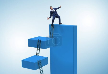 Photo for The businessman falling from high block in failure concept - Royalty Free Image