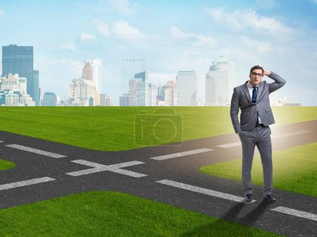 Photo for Young businessman at crossroads in uncertainty concept - Royalty Free Image