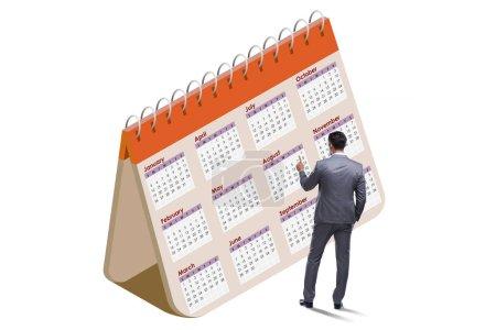 Photo pour Le concept de calendrier d'affaires avec l'homme d'affaires - image libre de droit